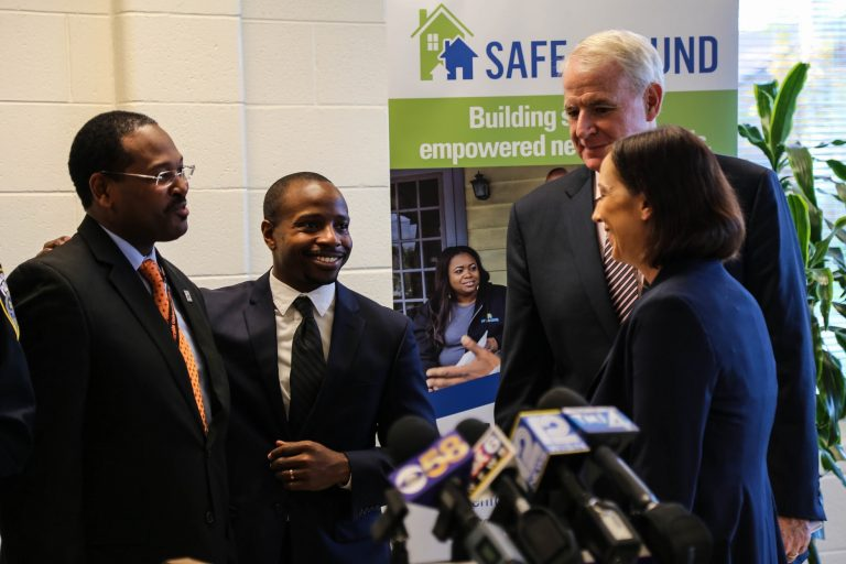 (From left) Ald. Ashanti Hamilton, Ald. Cavalier Johnson, Mayor Tom Barrett and Safe & Sound Executive Director Katie Sanders gather after the news conference to announce Safe & Sound's expansion into District 4 neighborhoods. Photo by Allison Steines.