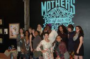 Artists from the From Here to her Collective gather for a picture after celebrating the Mothers of Our Nations exhibit at the Milwaukee Opening Party. Photo by Brittany Carloni.