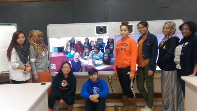 Students from Riverside University High School and their on-site facilitator, Ms. Willis-Whitley, with their on-screen classmates and teacher, Mr. Shokatz, from Vincent High School. Photo from MPS.