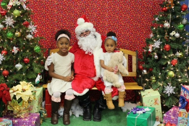 "Kids have their pictures taken with Santa at ""Breakfast with Santa,"" at the Kosciuszko Community Center. Photo courtesy of Milwaukee County Parks."