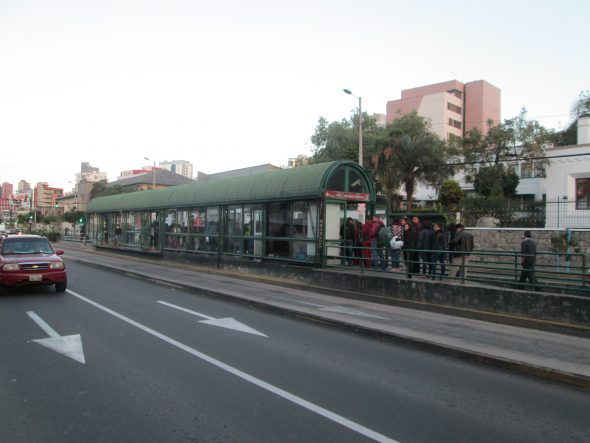 BRT riders in Quito enter the covered stations on one side, pay their $0.25 fare, and exit out the other. Photo by Ken Smith.