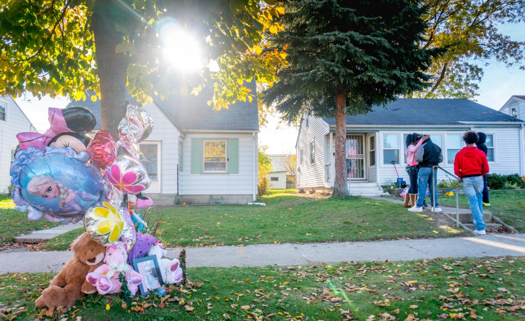 Family members and friends were gathered outside the home of Rickyia Langham, next to a memorial that marks the location where she was killed in a hit-and-run crash.
