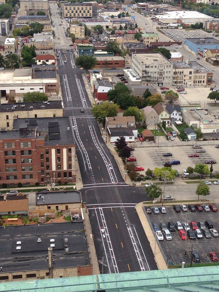 A view from the Rockwell Clock Tower of the buffered lanes on 2nd installed with the High Impact Paving Program.