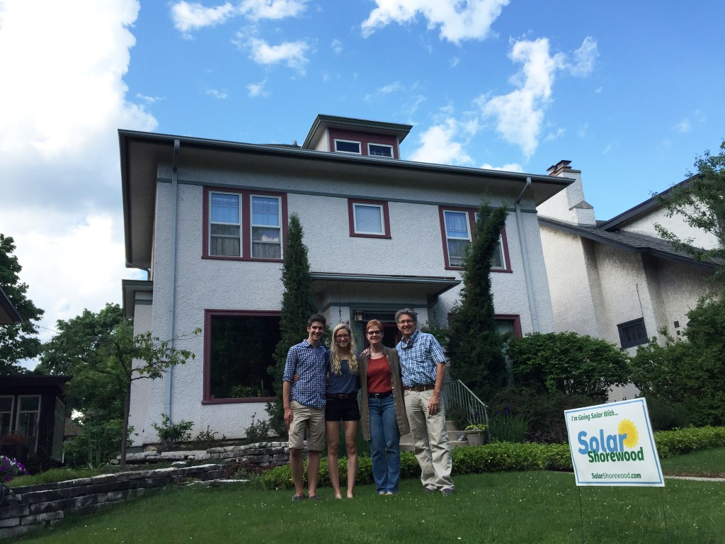 Shorewood Village Trustee, Paul Zovic and family in front of their Shorewood home, that's now equipped with a 2 kW solar array. Photo courtesy of the Midwest Renewable Energy Association.