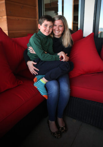 Jack was diagnosed with Type 1 diabetes at the age of 4, and requires copious amounts of medical supplies, including an insulin pump, insulin and related monitoring and testing equipment. He is seen here with his mother, Jess Franz-Christensen. Photo by Coburn Dukehart of the Wisconsin Center for Investigative Journalism.
