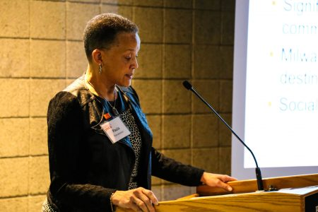 YWCA president and CEO Paula Penebaker addresses participants at the organization's Employer Summit. Photo by Allison Steines.