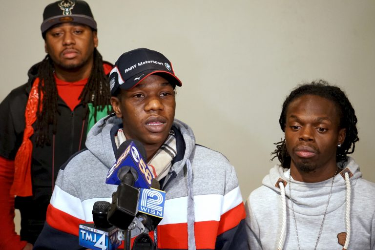 Sedan Smith (center), brother of Sylville Smith, speaks at a press conference at Inspired Word Ministries, 3410 W. Burleigh St., while cousin Thaddeus Ashford (right) and activist Vaun Mayes (left) look on. Photo by Adam Carr.