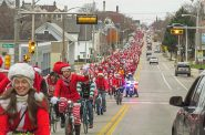 How many were there? We don't have an exact count, but that is a whole lot of Santas! This photo, taken looking west from Booth Street, shows the sea of Santas stretching at least 12 blocks west to Dr. Martin Luther King Drive.