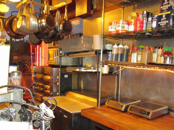 The first ten feet or so of the bar are devoted to the use of the chef. Photo by Michael Horne.