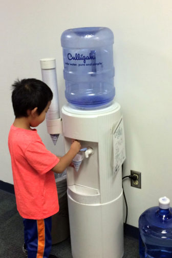 A child gets a drink from a water cooler at Riverside Elementary School east of Wausau on Dec. 7, 2016. More than 10 years ago, the school got rid of its drinking fountains and began providing water from coolers. The school also installed a filtration system after it discovered there were lead pipes in the building's foundation. Photo courtesy of Riverside Elementary School.