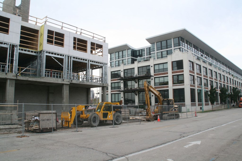 DoMUS apartment building going up next to The Marine Terminal Lofts condominiums. Photo by Jeramey Jannene.