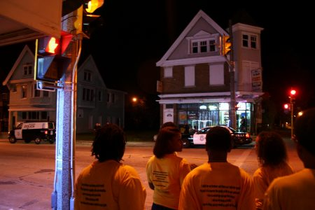 Ambassadors stop at the intersection of N. 27th Street and W. Burleigh Street during a patrol. Photo by Jabril Faraj.