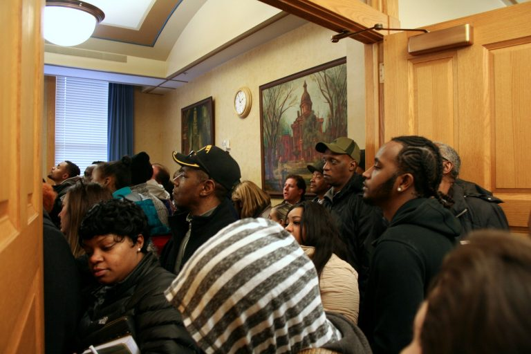 Residents pack an informational meeting for developers at City Hall. Photo by Jabril Faraj.