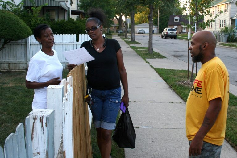 Anita Aydin (left) and Shawn Hudson (center) talk with Shawn Moore on N. 25th Street. Photo by Jabril Faraj.