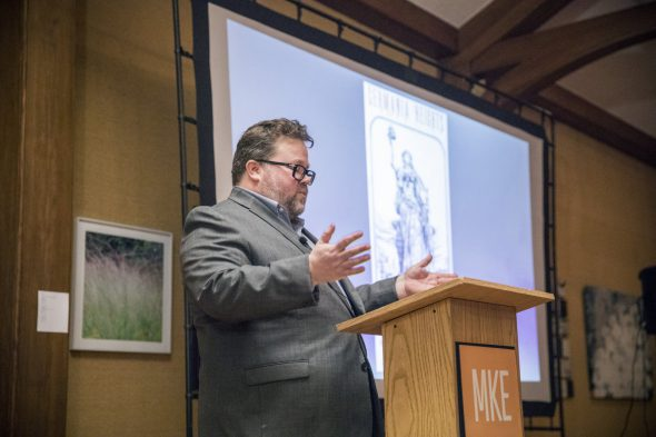 Brian Jacobson presents on Mystery at CreativeMornings Milwaukee. Photo taken January 30th, 2017.