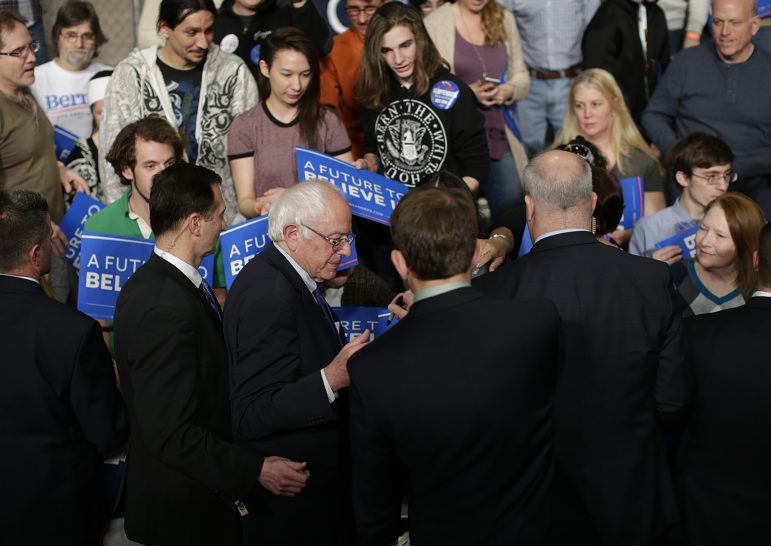 Democratic presidential candidate Bernie Sanders signs autographs for fans during a campaign rally at the KI Convention Center in downtown Green Bay on April 4. Sanders is among the candidates whose campaigns owe communities in Wisconsin thousands of dollars for police protection in 2016, according to an investigation by the Center for Public Integrity. Photo by Evan Siegle of the USA TODAY NETWORK-WI.