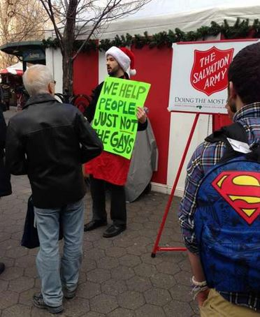 Protester at Salvation Army site. Photo from Twitter.