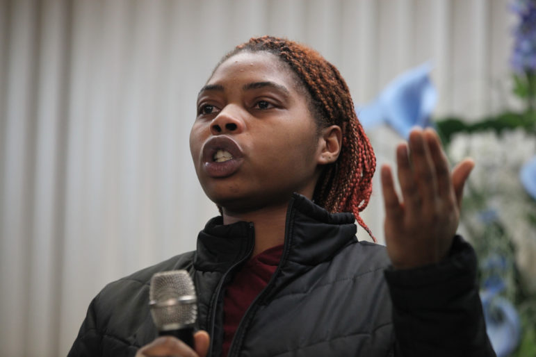 "Evanny Dorsey spoke at a meeting about lead in drinking water at the House of Prayer in Milwaukee on Dec. 6. She says her daughter, Avanny, age 3, has tested positive for elevated levels of lead three times in the past year. Because Avanny's blood lead levels were just below the limit that would trigger an inspection, no one has been to Dorsey's house to look for the source of lead. Dorsey suspects it's leaching into the water from her home's lead service lines. ""It's our future,"" she said. ""It's our children that it's affecting."" Photo by Coburn Dukehart of the Wisconsin Center for Investigative Journalism."