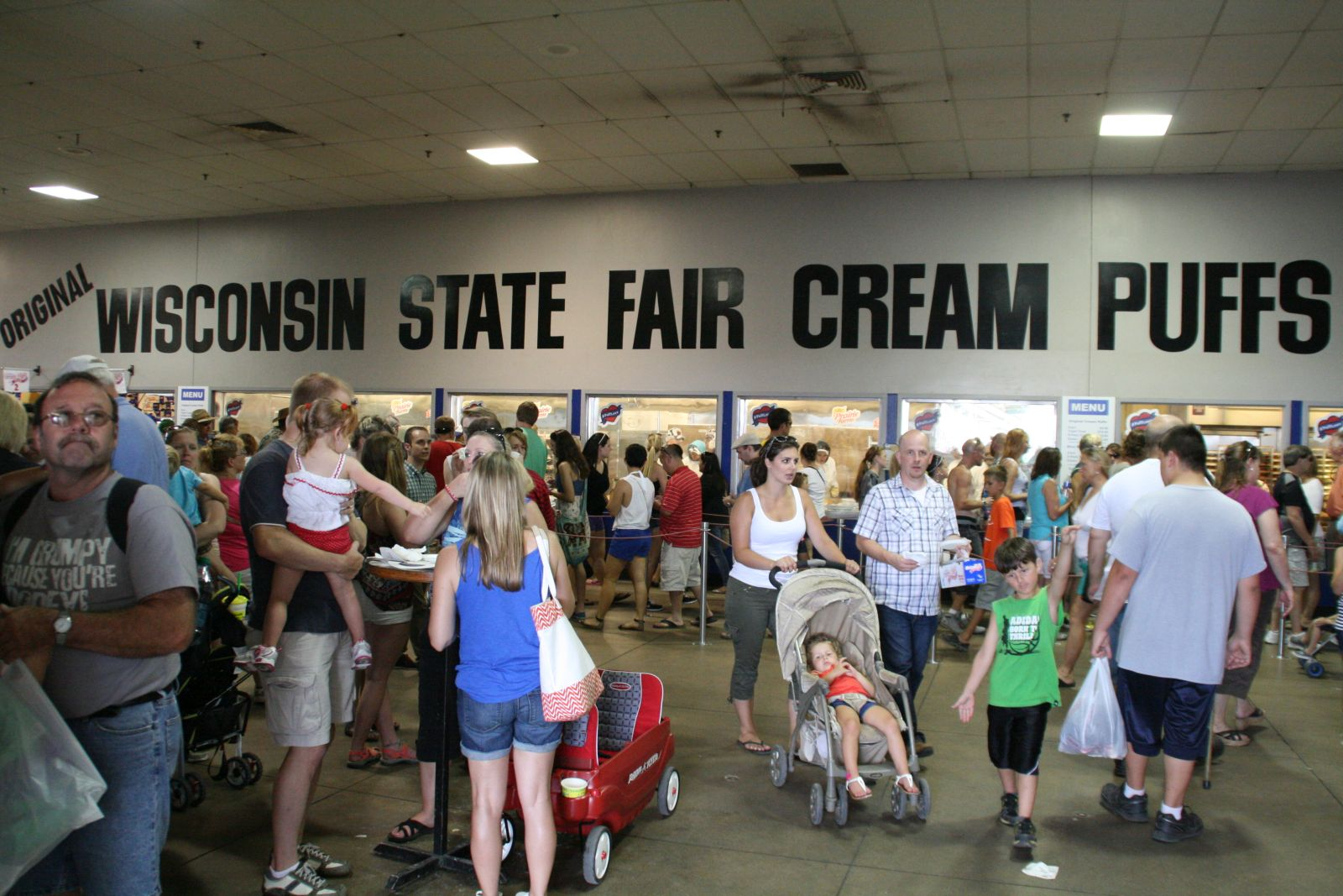 The cream puffs draw a large crowd at the 2014 Wisconsin State Fair. Photo by Jeramey Jannene.
