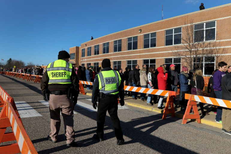 Eau Claire law enforcement monitor the crowd outside of Memorial High School as they wait to see Donald Trump speak April 2 in Eau Claire. Photo by Marisa Wojcik of the Eau Claire Leader-Telegram.