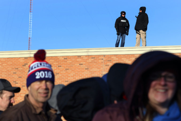 Law enforcement monitors the crowd outside of Memorial High School as they wait to see Donald Trump speak April 2 in Eau Claire. Photo by Marisa Wojcik of the Eau Claire Leader-Telegram.