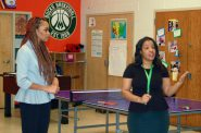 Darla Honeycutt (left), teen girls social development director, and Kailyn Jones, youth and teen program coordinator, show off the colorful room where participants in Silver Spring Neighborhood Center's teen programming socialize, learn and play. Photo by Naomi Waxman.
