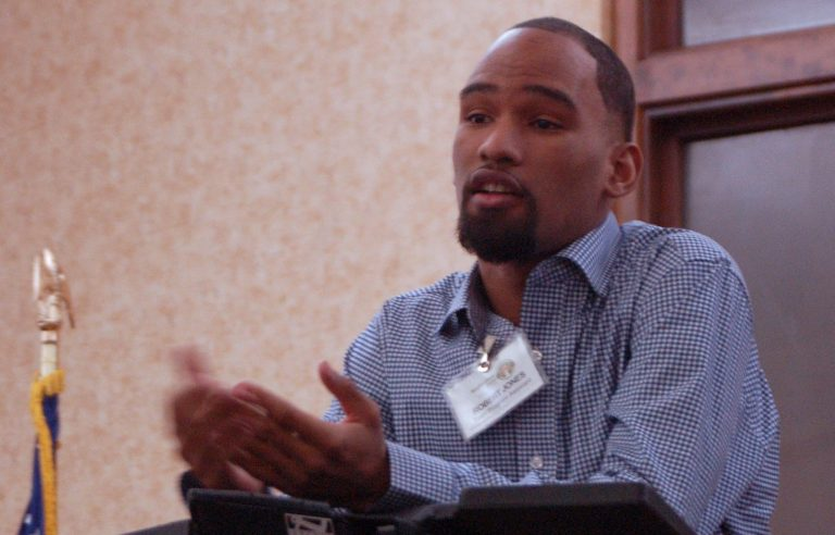 """Robert """"Redd"""" Jones, a mentor who attended Neighborhood House as a teen, shares his experiences with gun violence. Photo by Camille Paul."""