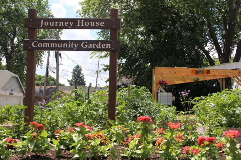 The Journey House Community Garden sign. Photo By Rebecca Carballo.