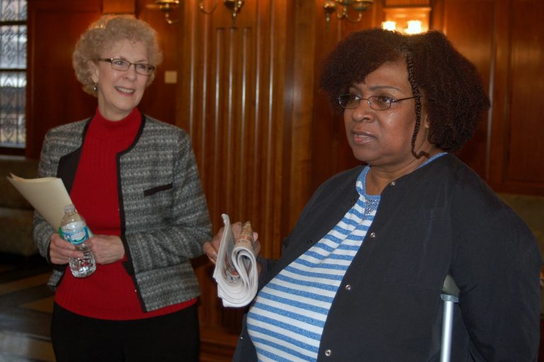 Karla Hart (right) speaks about her experience living at the Historic Lofts on Kilbourn as Diane De La Santos looks on. Photo by Andrea Waxman.