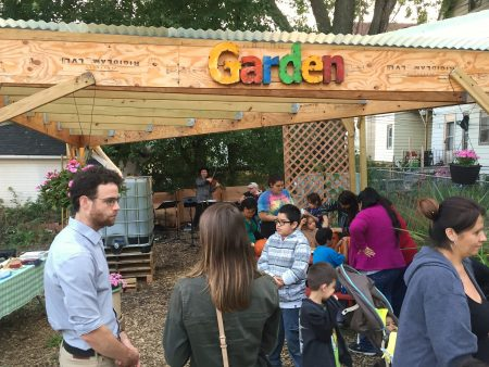 Clarke Square residents listen to live music at the Journey House Community Garden. Photo courtesy of Ryan Schone.