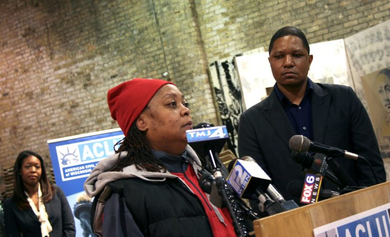 Plaintiff Tracy Adams (center) talks about her son being stopped by Milwaukee police as ACLU of Wisconsin Police Accountability Specialist Jarrett English (right) looks on. Photo by Jabril Faraj.
