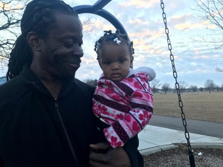 Julius Sommerville often brings his daughter to the park to enjoy the swings. Photo by Camille Paul.