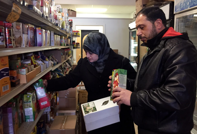 Syrian refugees Rula and Abdul shop at Istanbul Market in Madison, Wis. The couple arrived in Madison on Jan. 20, 2017 with their elementary-age daughters. Photo by Dee J. Hall of the Wisconsin Center for Investigative Journalism.
