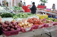 Customers shop for fruits and vegetables at the Milwaukee Asian Public Market Phongsavan. Photo by Dean Bibens.