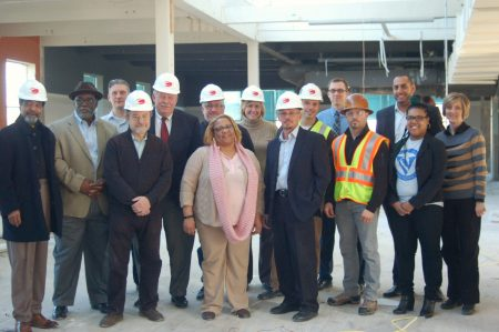 The development team for the Welford Sanders Historic Lofts poses for a photo on the building's 4th floor. Photo by Edgar Mendez.