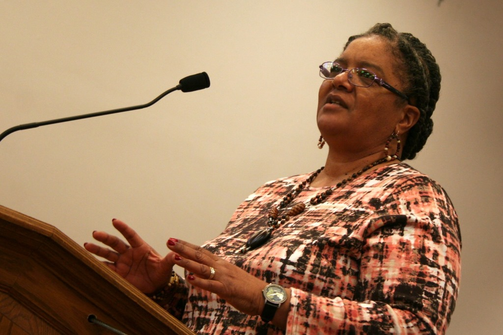 Freda Fowlkes-Bell, a longtime teacher at Washington High School, speaks in support of the uniform policy at a public hearing. Photo by Jabril Faraj.