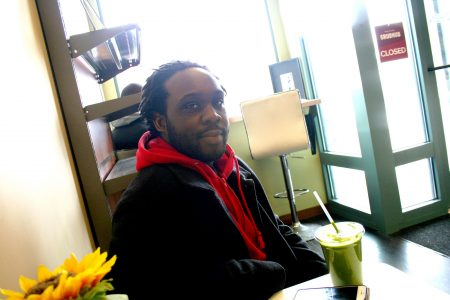 Kwadwo Owusu-Ofori sits in The Juice Kitchen on North Avenue in Lindsay Heights. Photo by Jabril Faraj.