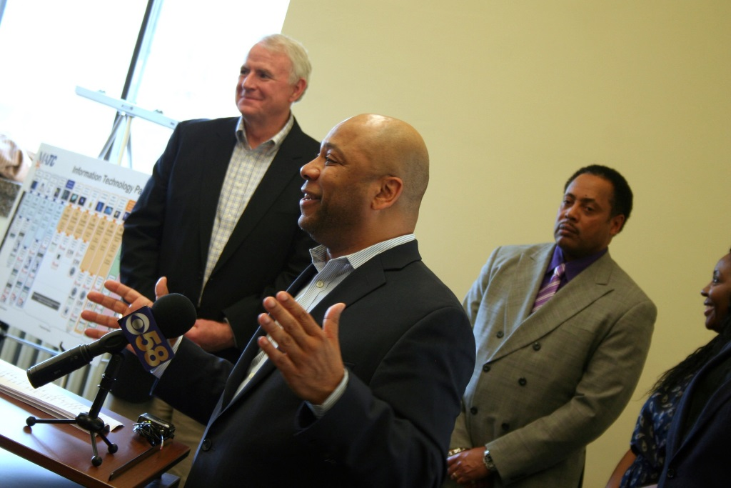 Mayor Tom Barrett (left) and Employ Milwaukee Vice President of Community Relations Willie Wade (right) look on as Employ Milwaukee Executive Director Earl Buford speaks. Photo by Jabril Faraj.Mayor Tom Barrett (left) and Employ Milwaukee Vice President of Community Relations Willie Wade (right) look on as Employ Milwaukee Executive Director Earl Buford speaks. Photo by Jabril Faraj.