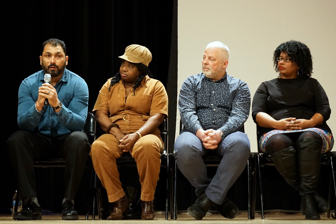Pardeep Singh Kaleka (left) addresses the audience at the American Black Holocaust Museum's 2017 Founder's Day event in Centennial Hall as Cassandra Greene, Warren Read and Jacqueline Olive listen. Photo by Adam Carr.