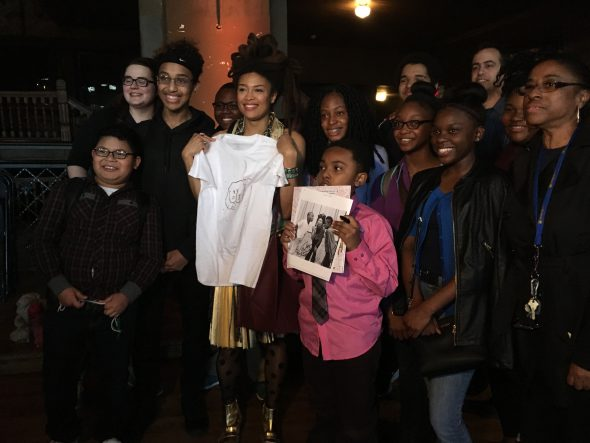 June and the students posing for a picture with their gifts to the musician: a custom designed shirt and art project. Photo by Gabrielle Barriere.
