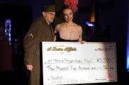 Pam Pfeifer presents the check to help fund the Stars & Stripes Honor Fund. Photo by Justin Gordon.