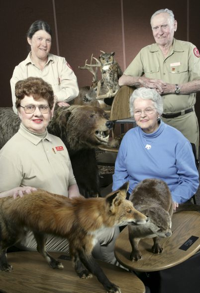 2005 photo of Rachel Jones and other charter members who started Zoo Pride pictured with animal mounts for Zoo programs. Photo courtesy of the Nonprofit Center of Milwaukee.