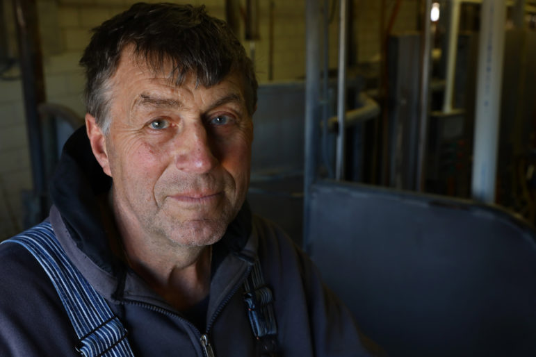 John Rosenow, owner of Rosenholm Farm, in Cochrane, Wis., says an immigration raid could shut down his business. Photo by Coburn Dukehart of the Wisconsin Center for Investigative Journalism.