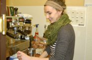 Barista Lauren Van Krey, a Washington Heights resident, prepares an order at Sharehouse Goods. Photo by Andrea Waxman.