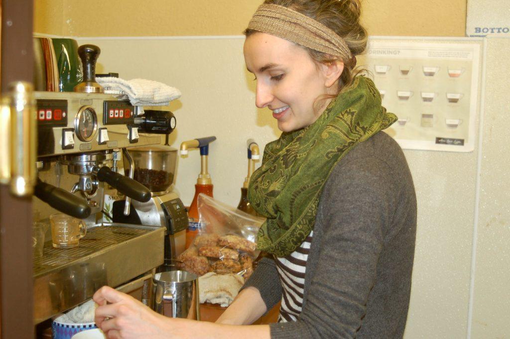 Barista Lauren Van Krey, a Washington Heights resident, prepares an order at Sharehouse Goods. Photo by Andrea Waxman.