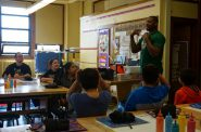 Former Milwaukee Bucks small forward Desmond Mason answers questions from students at Neeskara Elementary School. Photo by Camille Paul.