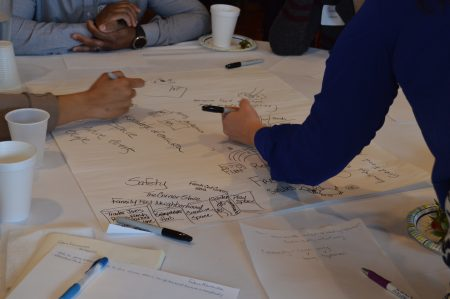Participants write down and illustrate their ideas for the Near West Side. Photo by Alexandria Bursiek.