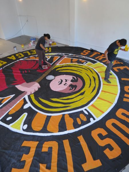 Nicolas Lampert helped organize local artists to design three 24-foot-wide parachute banners for Voces de la Frontera's annual march. Photo courtesy of Nicolas Lampert.
