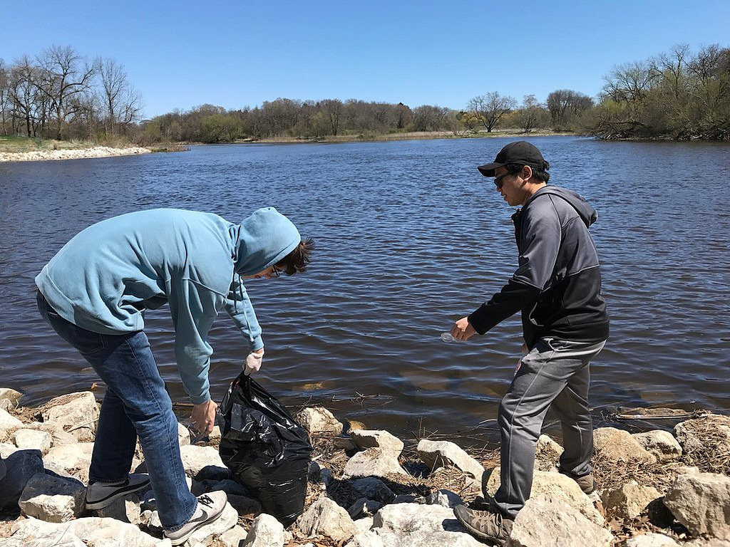 James Niland, left, and Kenneth Banting volunteered through Marquette University's Hunger Clean-Up program to pick up trash at Lincoln Park. Photo by Camille Paul.