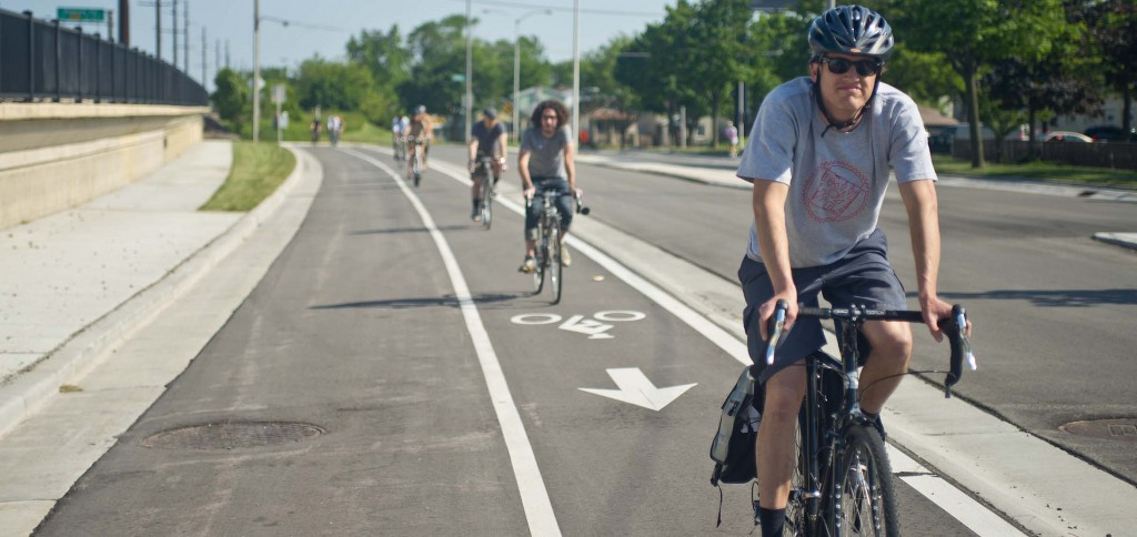 Milwaukee's raised bike lane on Bay Street is the first modern protected bike lane constructed in Wisconsin.